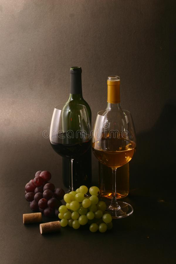 Wine with grapes stock photography