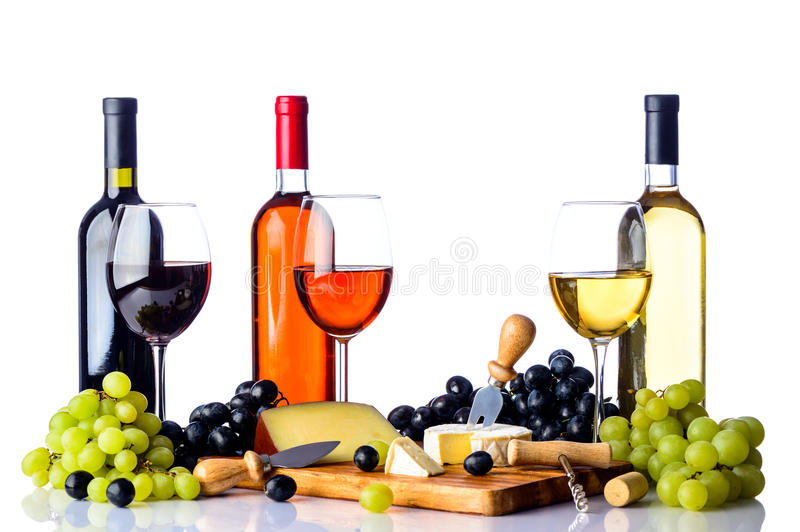 Wine grapes and cheese on white stock images