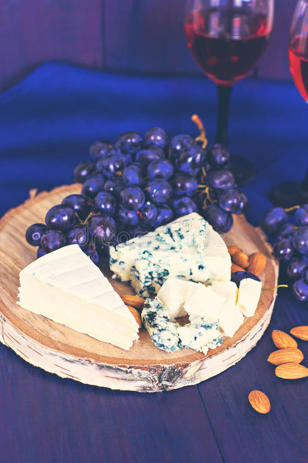 Wine, grapes, nuts, cheese, blue cheese. Dinner, lunch, romantic date, picnic. stock images