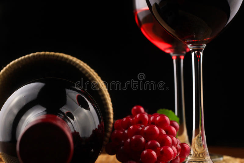 Wine and grapes on a wicker tray . royalty free stock photo