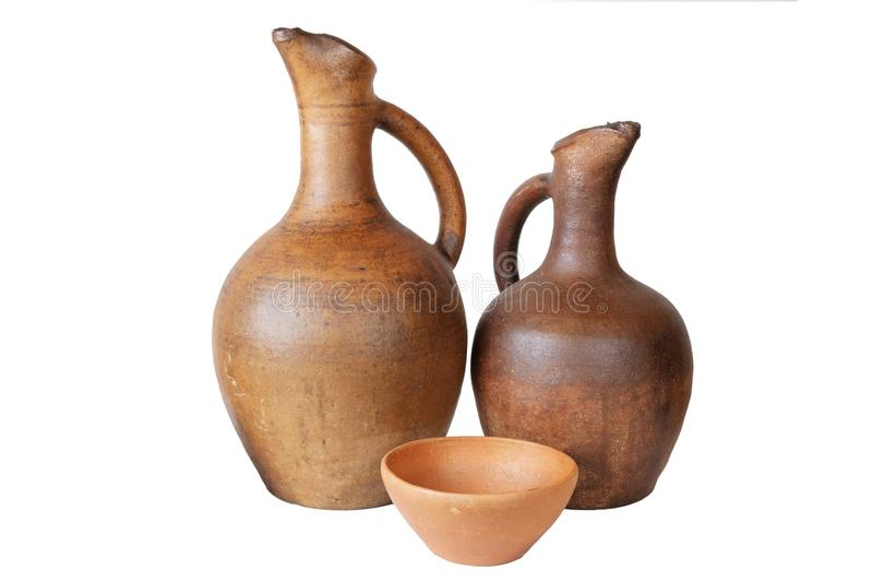 A wine jugs and clay cup. On a white background, isolated stock image