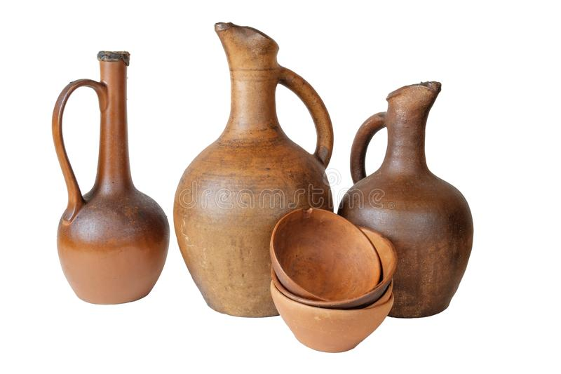 Wine jugs. A wine jugs and set of clay terracotta cups on a white background, isolated royalty free stock photography