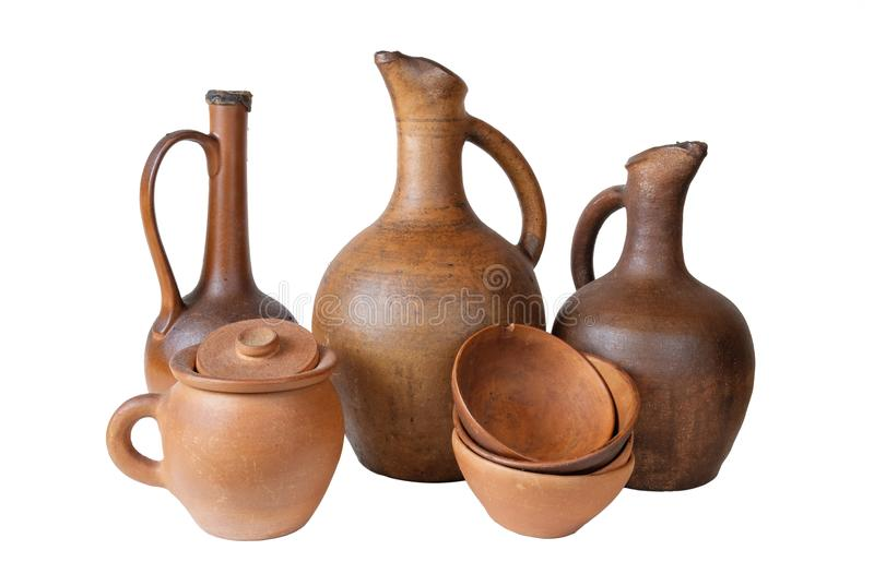 Wine jugs. A wine jugs and set of clay terracotta cups on a white background, isolated royalty free stock photo