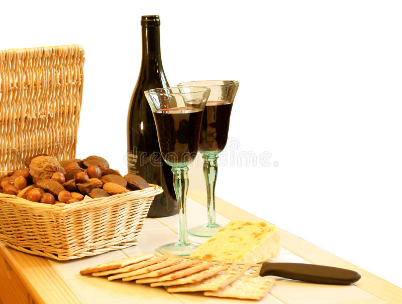 Wine, nuts, cheese and crackers royalty free stock images