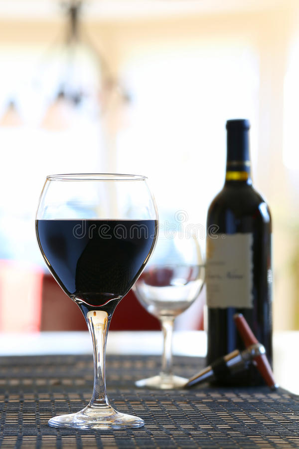 Wine poured in glass at home royalty free stock photos
