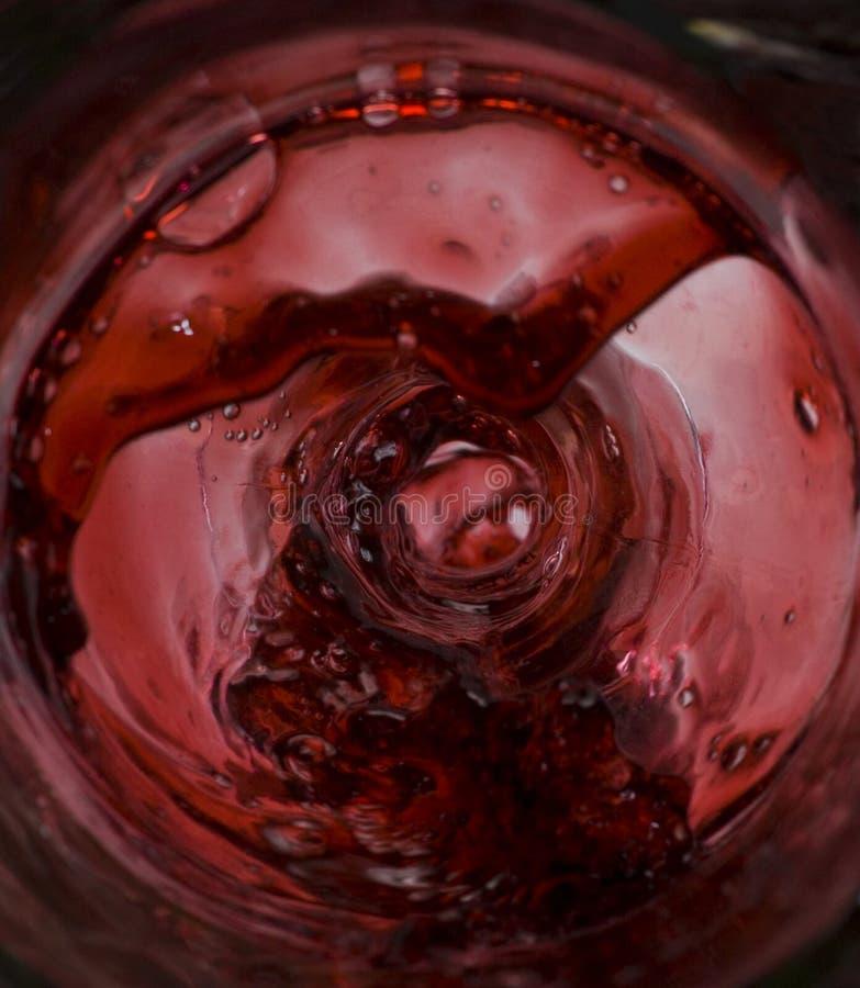Wine pouring inside the bottle splash stock photo