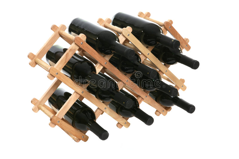 Wine Rack. A rack of wine bottles over white with reflection royalty free stock photos