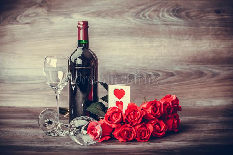 Wine and red roses stock photography