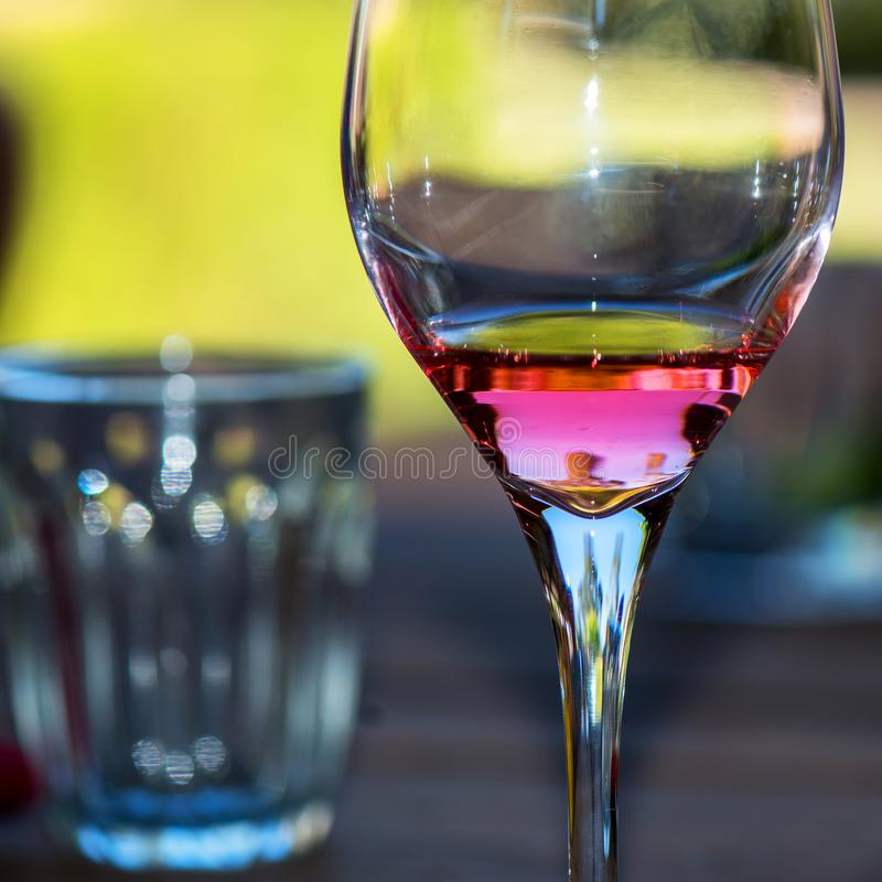Reflections on Wine. Wine reflects the afternoon light in a glass. The Rose bounces off the tongue and dances in the Australian fine lights royalty free stock photos