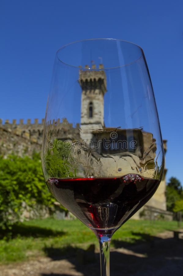 Wine with romance. Wine and castle. Castles of Tuscany wine region of Chianti, Italy. Monastery located in the hills of one Badia Passignano, Tuscany Italy royalty free stock photo