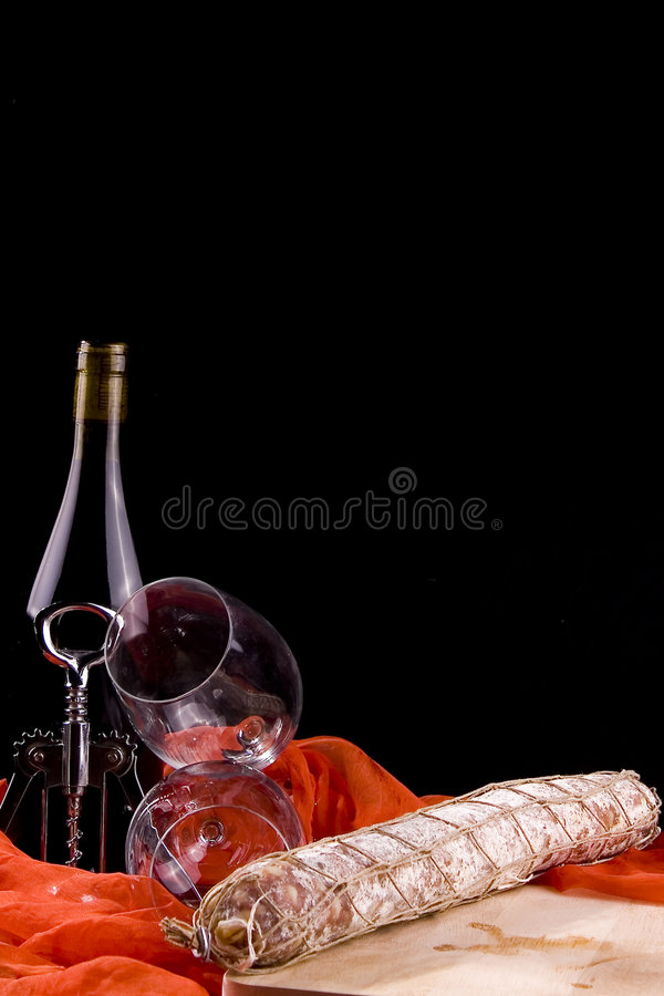 Wine and salami royalty free stock photography