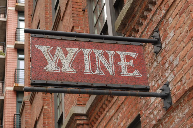 Wine for Sale. A sign on a building advertises wine for sale within stock photography