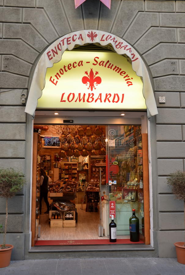 Wine shop in Italy. FLORENCE, ITALY, DEC 26, 2014 - Vinotheque (wine shop) and sausage shop in Florence, Italy royalty free stock image
