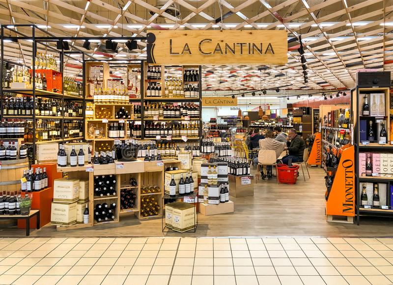 Wine shop La Cantina with a wide display of wine bottles inside of the IPER of Varese hypermarket, interior of the shopping center royalty free stock photos