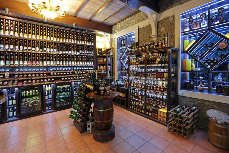 Wine shop. YALTA, REPUBLIC OF CRIMEA, RUSSIA - AUG 14, 2014: Interior and assortment drinks wine shop with traditional Crimean wines, nobody royalty free stock photography