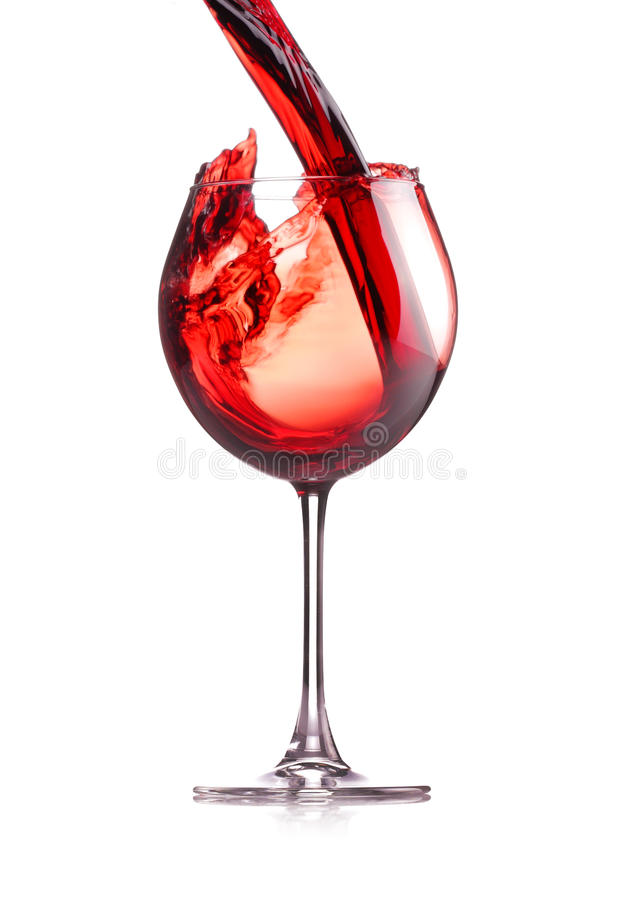 Wine splash. Red wine splashing in a glass, isolated on white royalty free stock images