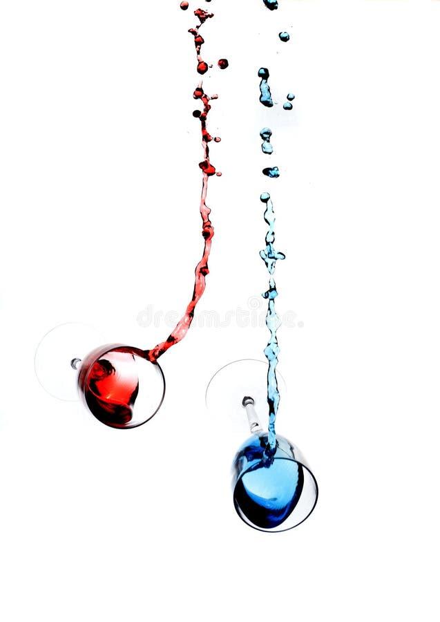 Wine splashing in glasses stock illustration