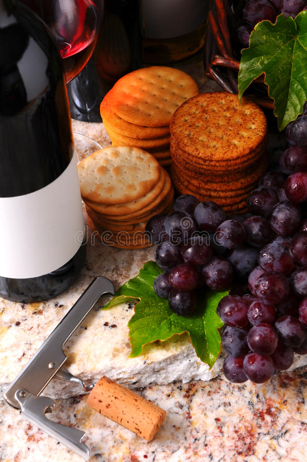 Wine Still life with corkscrew and crackers stock image