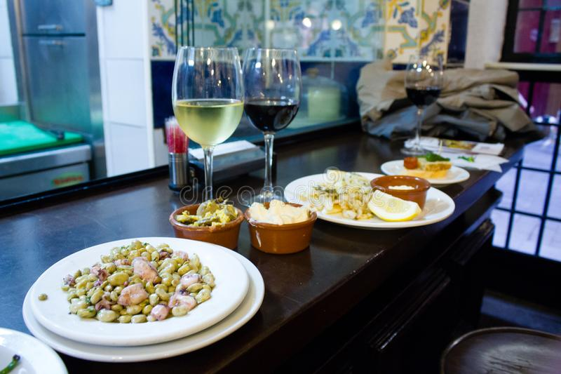 Wine and tapas in Madrid served on a bar table royalty free stock photo