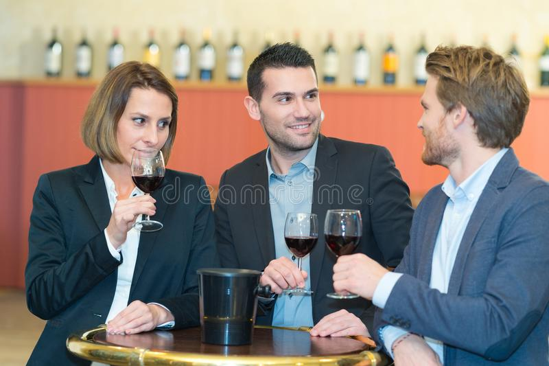 Wine tasting in bar. Meeting stock photography