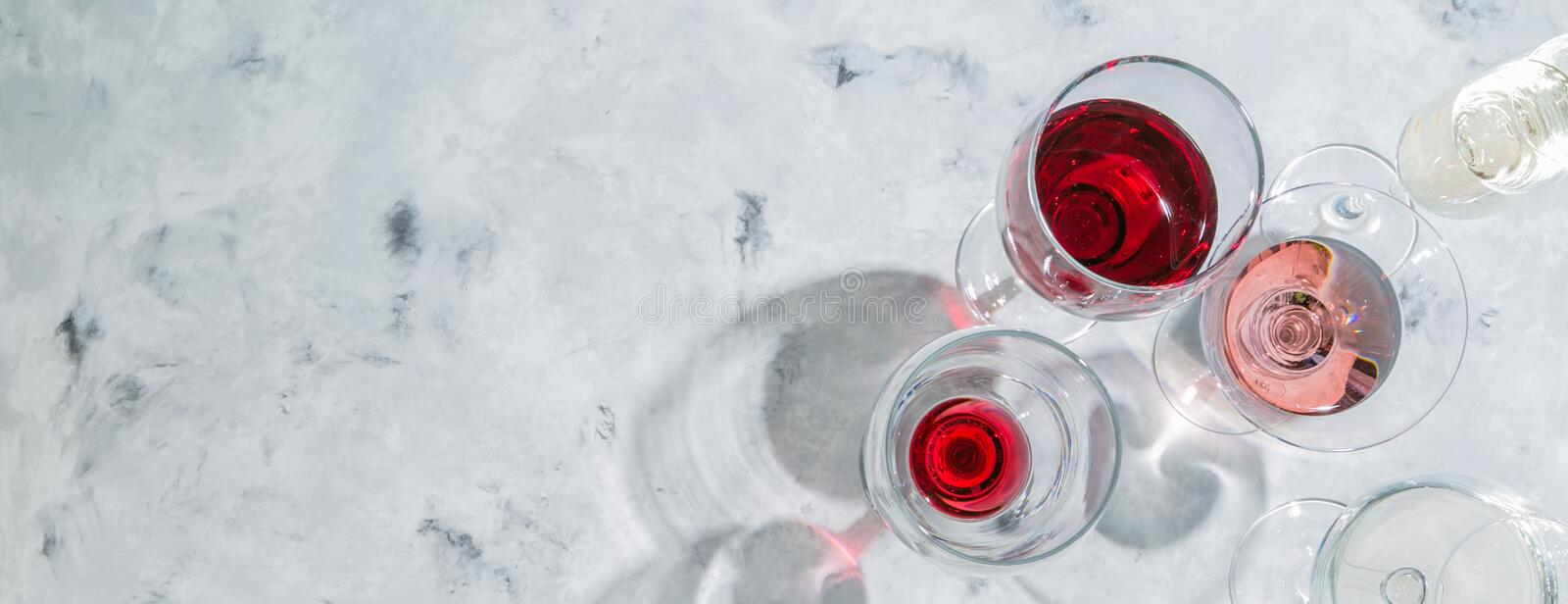 Wine tasting concept - glass with different wine on marble background stock photography