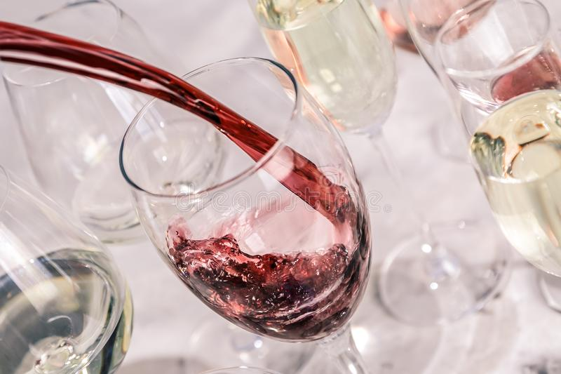 Wine tasting concept - glass with different wine on marble background royalty free stock images