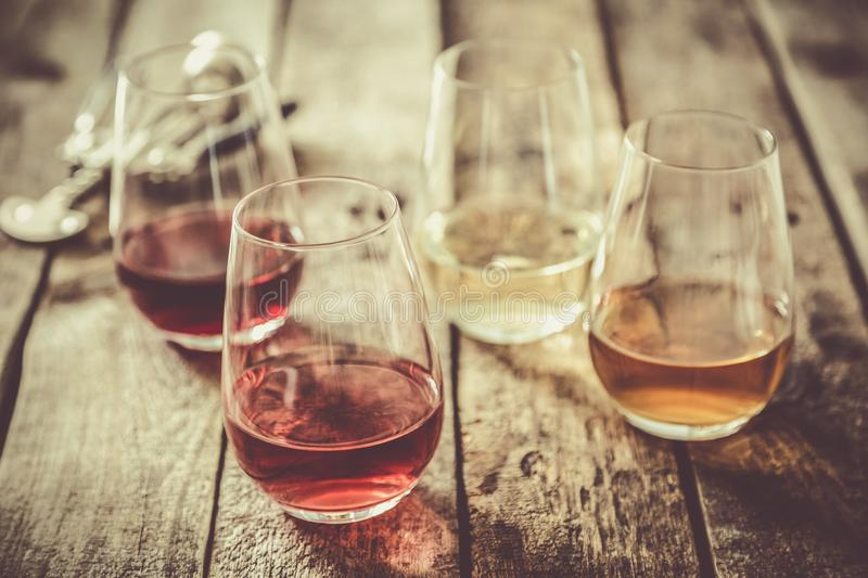 WIne tasting concept - red, rose and white wine in glasses royalty free stock images