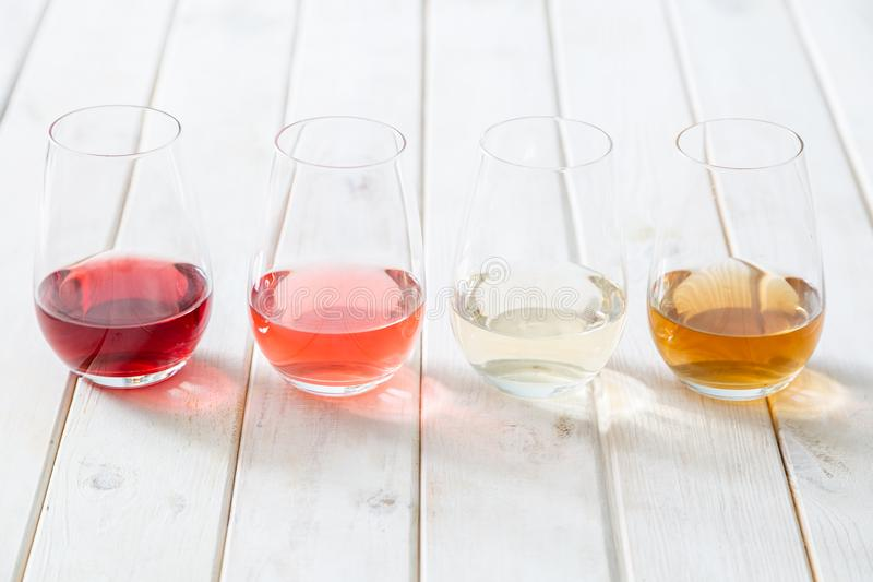 WIne tasting concept - red, rose and white wine in glasses royalty free stock photography