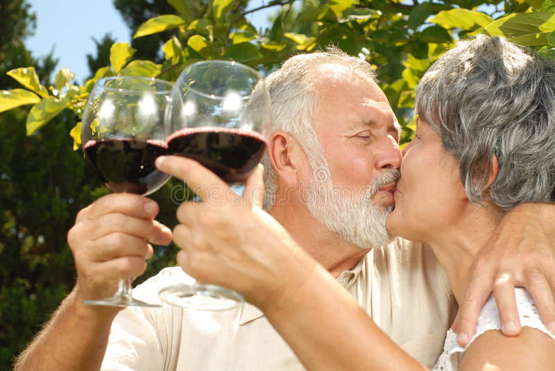 Wine tasting and kisses stock photos
