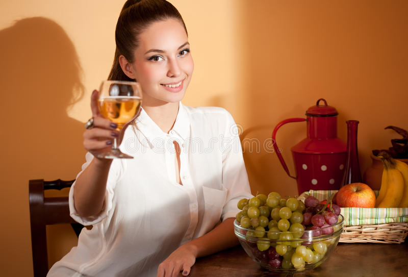 Wine tasting. Portrait of gorgeous young brunette woman tasting wine stock images