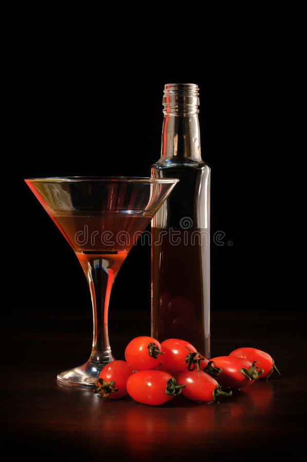 Wine with tomatoes stock photography
