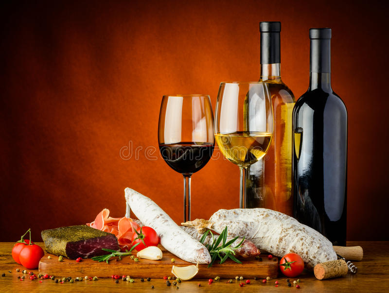 Wine and traditional sausages stock photo