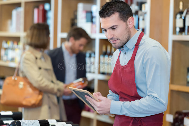 Wine vendor writing on board. Wine vendor writing on a small board royalty free stock photos