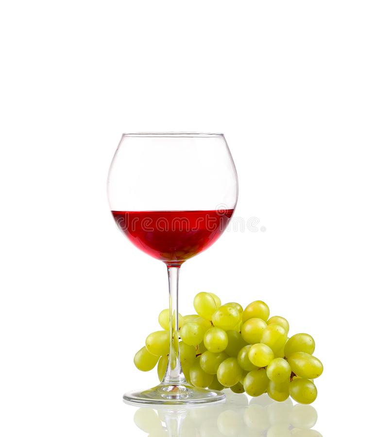Wine and white grapes isolated on white background. Glass of red wine and white grapes isolated on white background royalty free stock photos