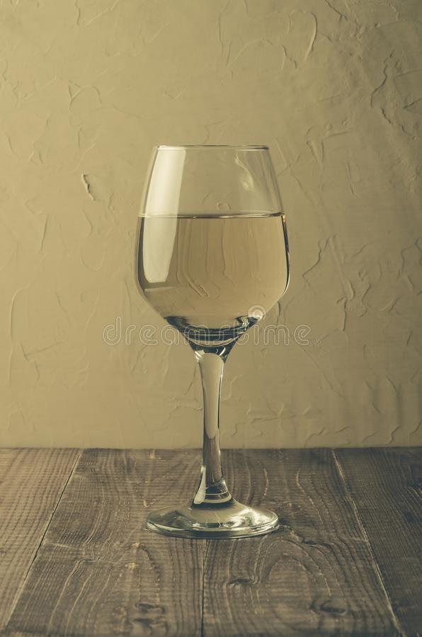 Wine on wooden table/glass of white wine on a wooden table, selective focus royalty free stock image