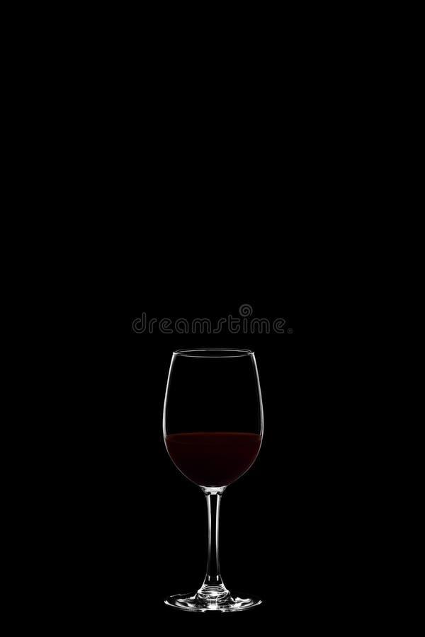 Wineglass στο μαύρο υπόβαθρο στοκ φωτογραφία