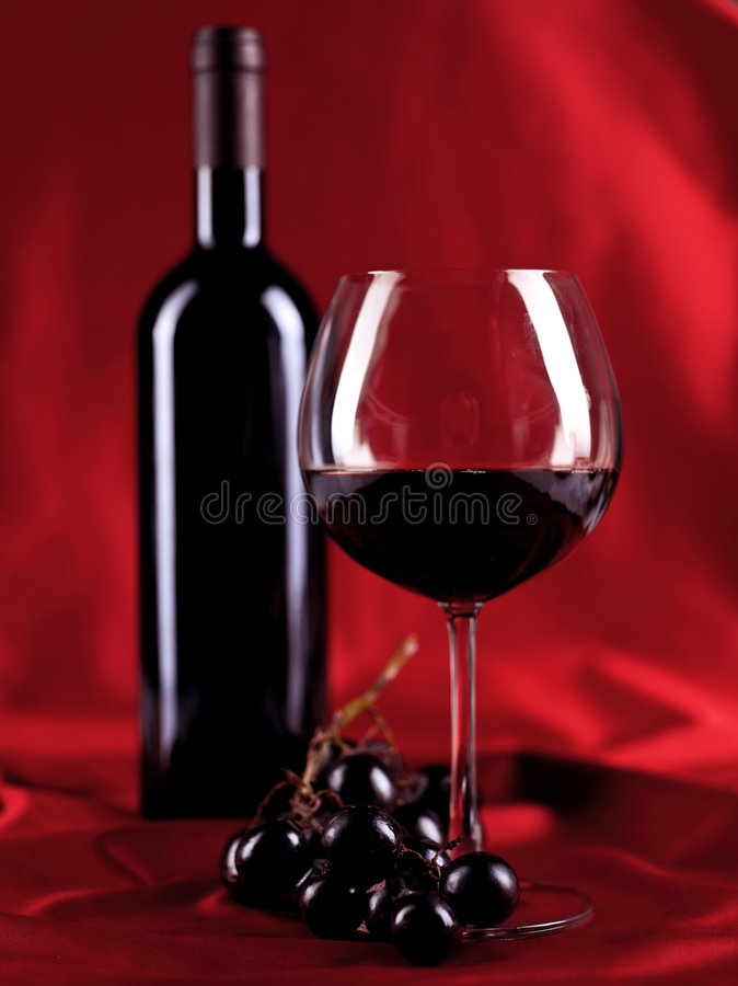 Wineglass and bottle royalty free stock photography