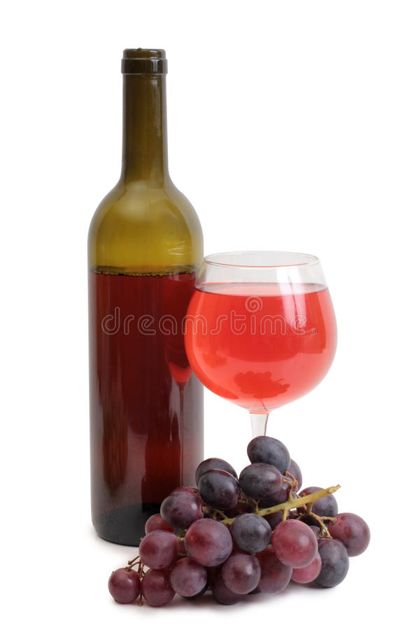 Wineglass bottle and bunch grapes royalty free stock image