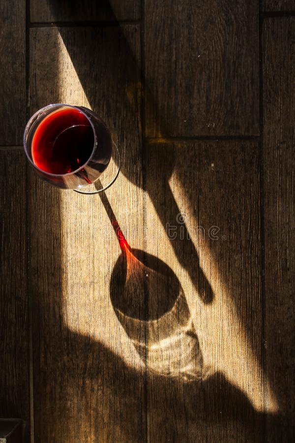 The wineglass and the bottle of wine stock photo