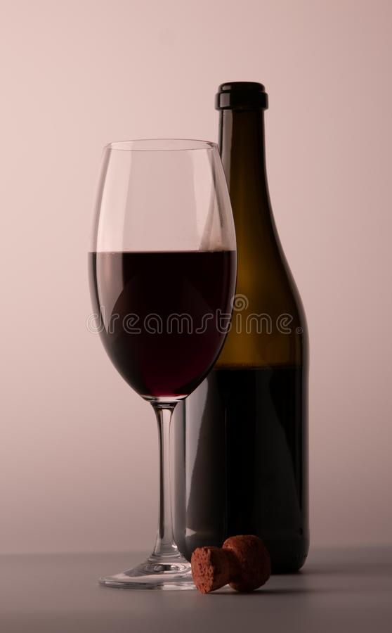 Wineglass red wine black bottle cork stock photography