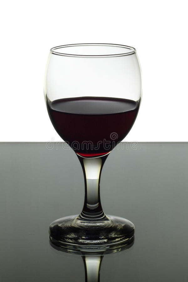 Wineglass of red wine on black and white background stock image
