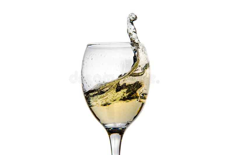 Wineglass with splashing drops of champagne royalty free stock images