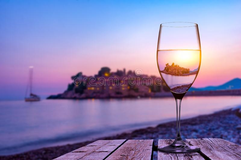 Wineglass and Sveti Stefan royalty free stock images