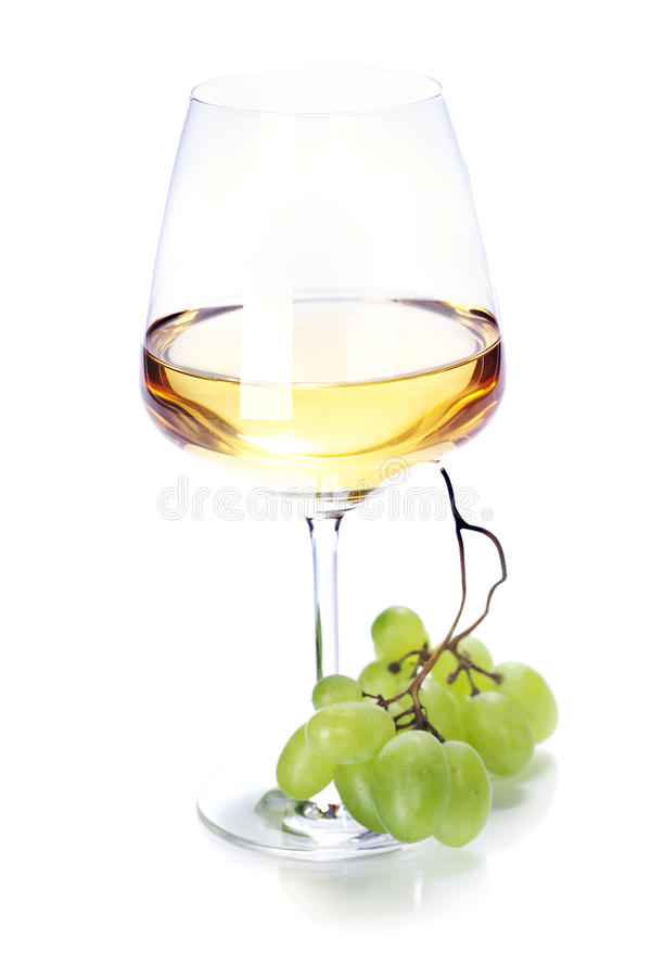 Wineglass with white wine and grape royalty free stock images