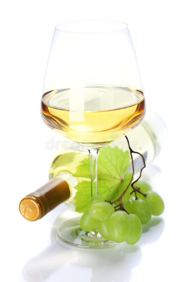 Wineglass with white wine and grape royalty free stock image