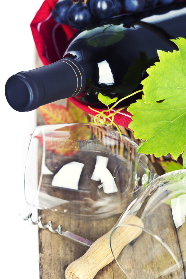 Wineglasses and bottle of red wine in basket stock image