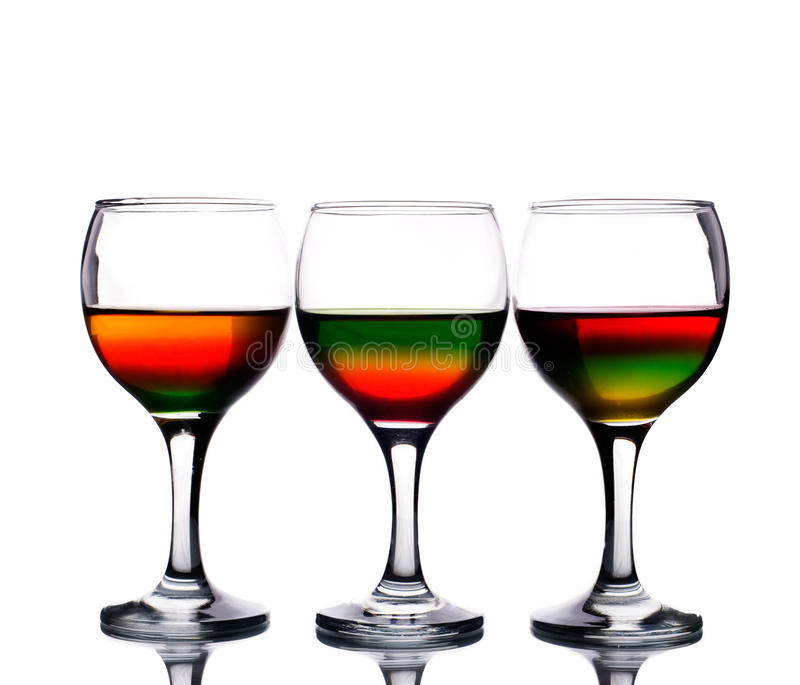 Download Wineglasses Filled With Multicolored Cocktail Stock Image - Image of exotic, crystal: 13895887