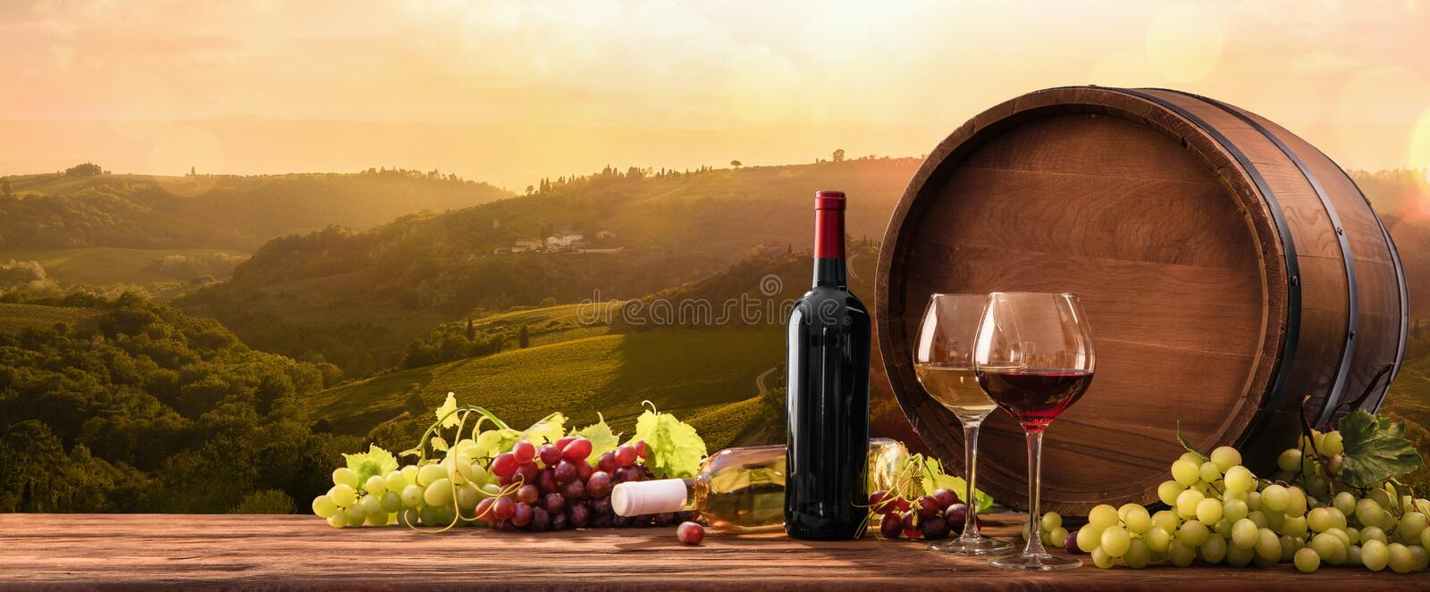 Wineglasses With Grapes And Barrel On A Sunny Background stock photography