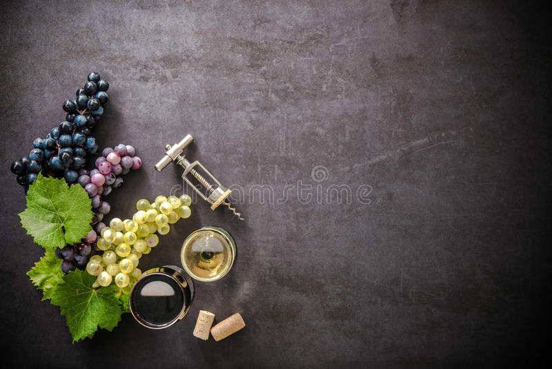 Wineglasses with grapes and corks royalty free stock photo