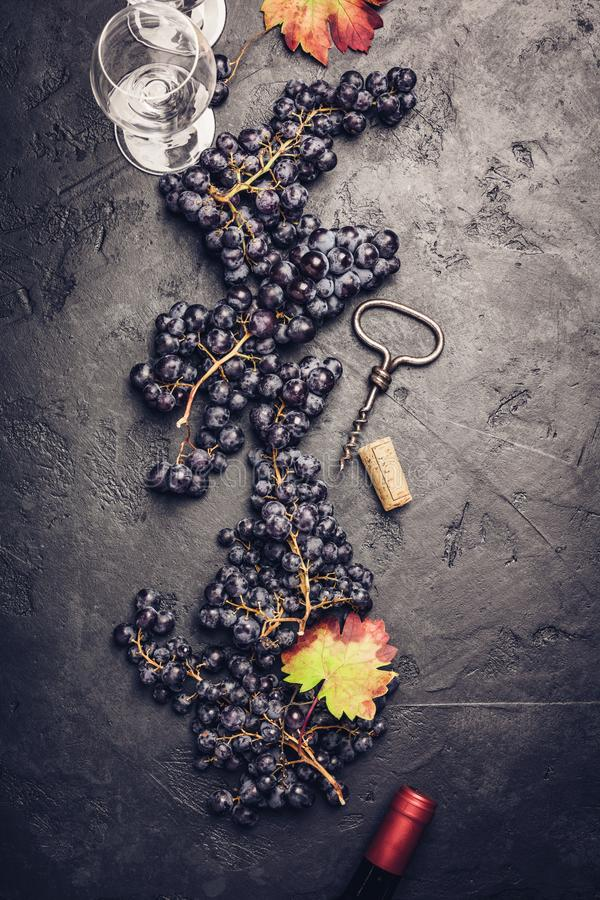 Wineglasses with grapes and corks on dark background royalty free stock photo